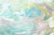 An amazing and beautiful macro image of pastel color clothes with an huge detail where it can be seen blue, pink and yellow colors - 234850027