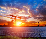 Clean power energy concept,Oil pump with solar panels and the sunset - 234865868