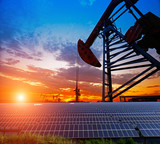 Clean power energy concept,Oil pump with solar panels and the sunset - 234866095