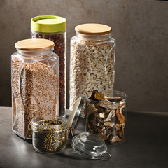 Sustainable lifestyle concept, zero waste, cereals and beas in glass, eco friendly, plastic free items. Dark background.