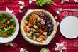 Baked, roasted, grilled vegetables in skillet pan. Beetroot, carrot, mushrooms, pumpkin, brussels sprouts with avocado dpi sauce. Vegan lunch, vegetarian dinner, healthy Christmas food