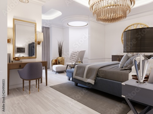 The design of a luxurious bedroom in a contemporary style with a blue bed and white walls. Armchair with footrest and dressing table with mirror. - 234906833