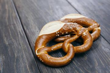 Tasty pretzels on dark wooden background