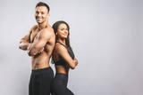 Athletic man and woman isolated over white background. Personal fitness instructor. Personal training.