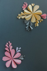Handmade origami heart shaped paper flowers. Valentine's day or celebration background. © Zanete