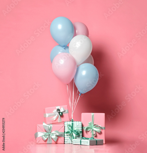 Helium inflatable latex pastel color light blue pink white balloons and present gifts  background - 234955279