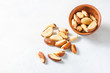 Quadro Wooden bowl with Brazil nuts on a light background. Healthy food.