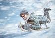 Leinwanddruck Bild - Mann in voller Fahrt beim Rodeln im Schnee