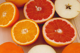 citrus fruits on wooden background close up