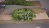 Falling of dill into the frying pan. Slow motion 480 fps - 235048217