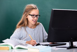 Girl Using Computer In Classroom - 235048472