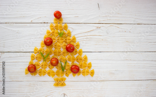 christmas ang new year tree made from pasta and tomatoes on white background free space for text - holidays, winter, celebration,  Christmas and  new year concept - 235097282