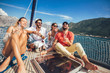 Leinwanddruck Bild - Smiling friends sailing on yacht. Vacation, travel, sea, friendship and people concept