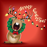 Sitting Christmas Reindeer decorated with wreath and luminous electric garland singing a Christmas carol