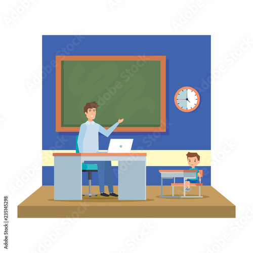male teacher with boy in the classroom