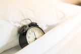 Metal Alarm clock on white bed 8 am. - 235151873