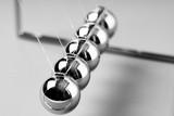 Newtons Cradle balancing balls, business concept in studio - 235152604