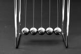 Newtons Cradle balancing balls, business concept in studio - 235152634