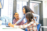 Multi ethnic young coworkers collaborating inside the office. Corporate and business concept - 235155214