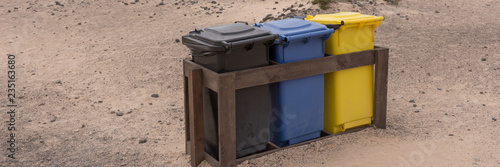 Three colorful recycle bins on the beach. Fuerteventura. Canary Islands - 235163680