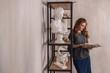 Beautiful woman reading in her studio - 235177424