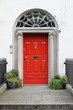 Red door on a townhouse in Dublin, Ireland - 235191672