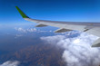 view from the window of the plane to the cumulus clouds and the infinitely blue sky - 235205898