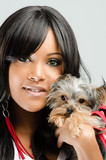 Young African American Woman  Holding Small Dog © terryleewhite