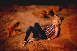 Beautiful girl in a shirt in a sand quarry.