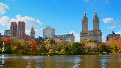 Boating in New York City Central Park in Autumn with skyscrapers apartment and lake