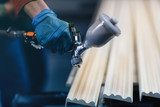 Painting wooden slats from an automatic spray - 235256231