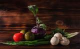 Vegetable still on a wooden background (tomatoes, parsley, kohlrabi, tomato, green onions, Champignon) - 235256686