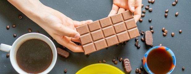 person's hands holding a chocolate bar  f © Mihail