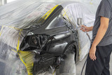 spray gun with paint for painting a car - 235267653