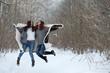 Beautiful girl in a beautiful winter park - 235274075
