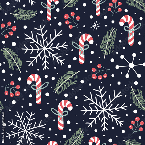 fototapeta na ścianę Holiday seamless pattern with Christmas candies, snoflakes, fir branches and berries. Winter cute background. Vector illustration