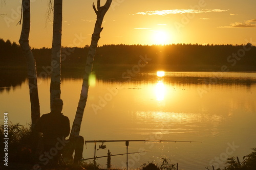 fototapeta na ścianę Evening fishing on the forest lake in Central Russia