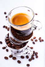 """Постер, картина, фотообои """"glass cups, in sequence vertically, with coffee beans, ground, and creamy drink. still life"""""""