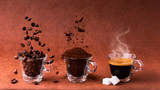 in glass cups, animated sequence with coffee beans, ground coffee, and steaming beverage. still life
