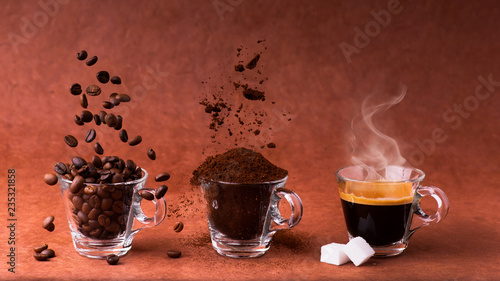 in glass cups, animated sequence with coffee beans, ground coffee, and steaming beverage. still life - 235321858