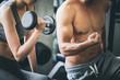 Leinwandbild Motiv Fitness man and woman doing exercise in gym