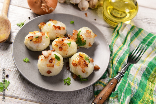 Meat stuffed potato dumplings with fried onion  and greaves on top - 235343664
