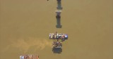 aerial overhead of bridges foundations and barge mounted crane in river - 235363204