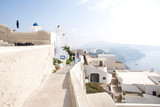 Thira, Santorini - panoramic view.  Panoramic view Traditional famous white houses and churches in Thira town on Santorini island in Greece - 235378098