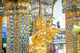 Golden statue of four-faced Thao Maha Phrom at the Erawan Shrine. Bangkok, Thailand.