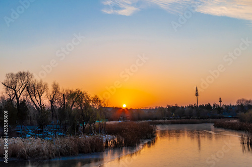 fototapeta na ścianę Sunset and frozen river - Changchun Beihu National Wetland Park, China