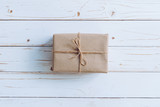 Above brown gift box on wooden table background with copy space. - 235388684