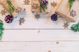 Homemade wrapped christmas gift box presents on a wood table background with space. - 235388699