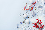 Christmas card or banner. Christmas silver decorations on blue background.