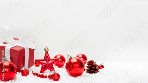 Red christmas holidays decoration on a white background - 235429033